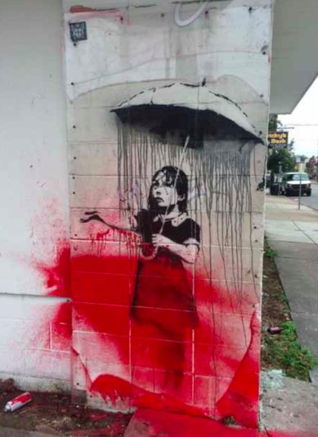 banksy nola defaced in new orleans by vandal